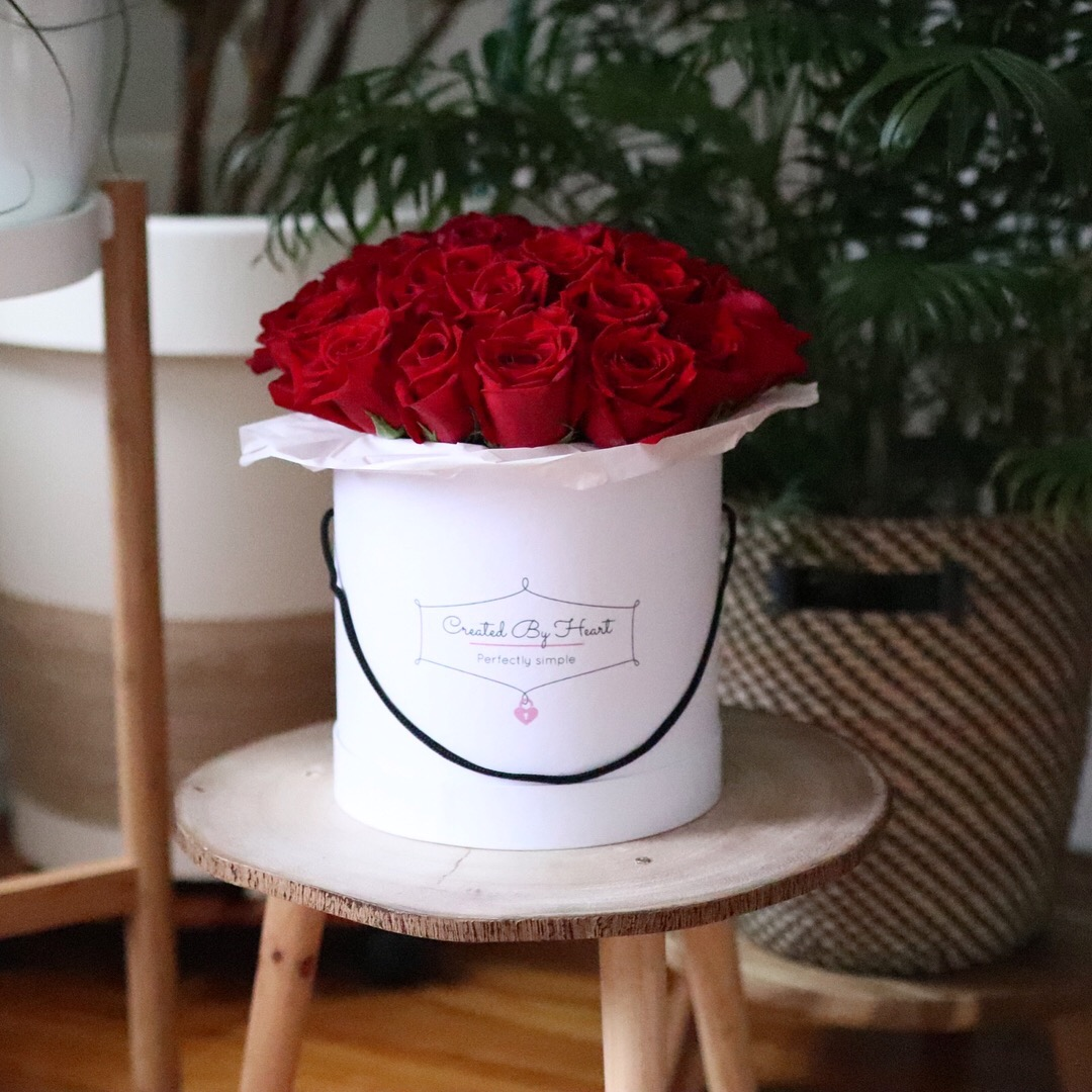 25 red roses in a medium size signaturewhite box