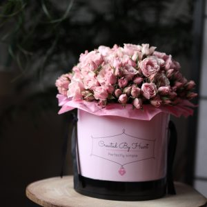 Pink spray roses in a pink signature box